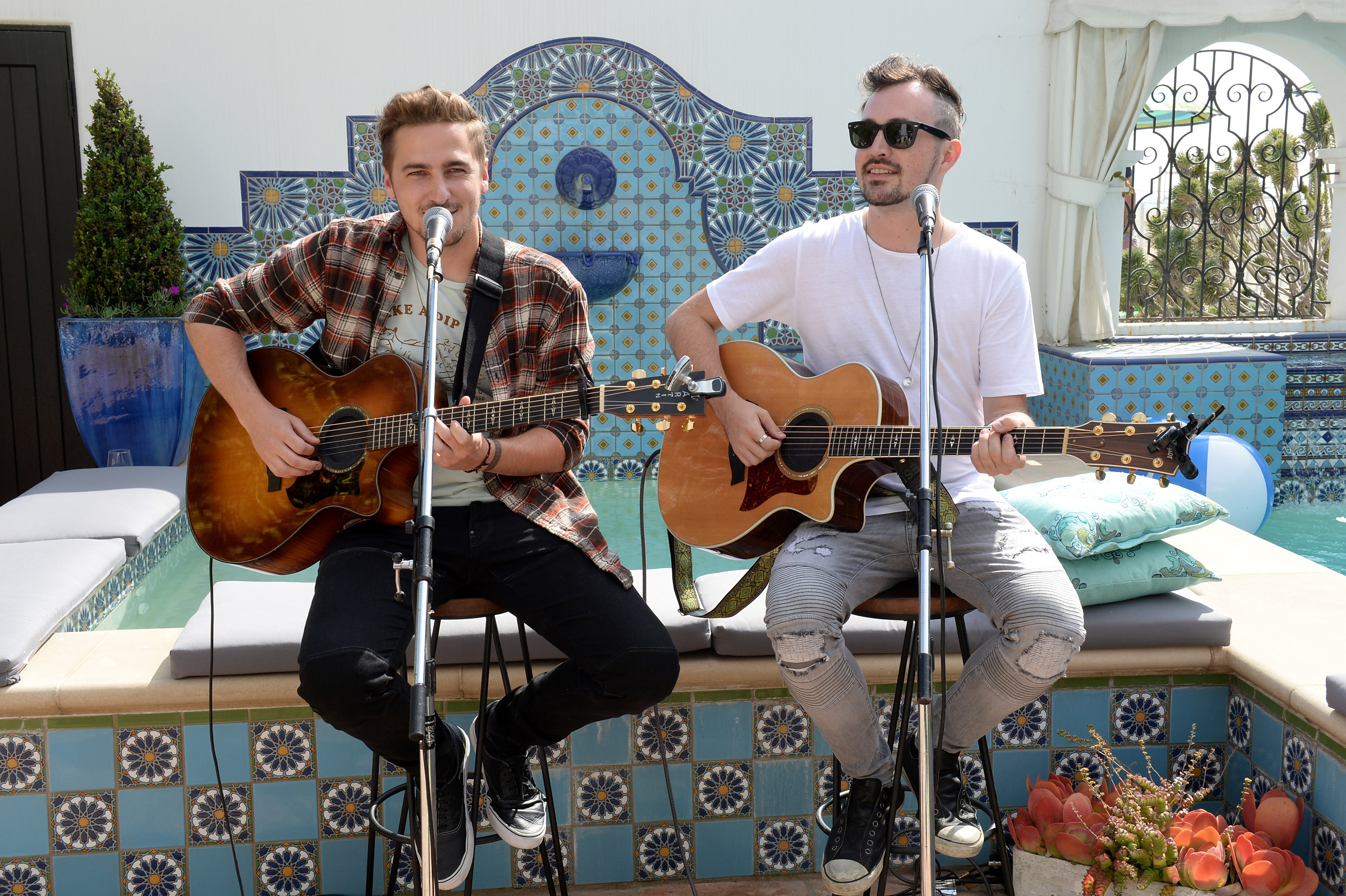 """SANTA MONICA, CA - MAY 14: Musicians Kendall Schmidt (L) and Dustin Belt of musical group 'Heffron Drive' perform at Cost Plus World Market's Santa Monica Beach House Party #Celebrate Outdoors on May 14, 2016 in Santa Monica, California. (Photo by Michael Kovac/Getty Images for Cost Plus World Market)"""